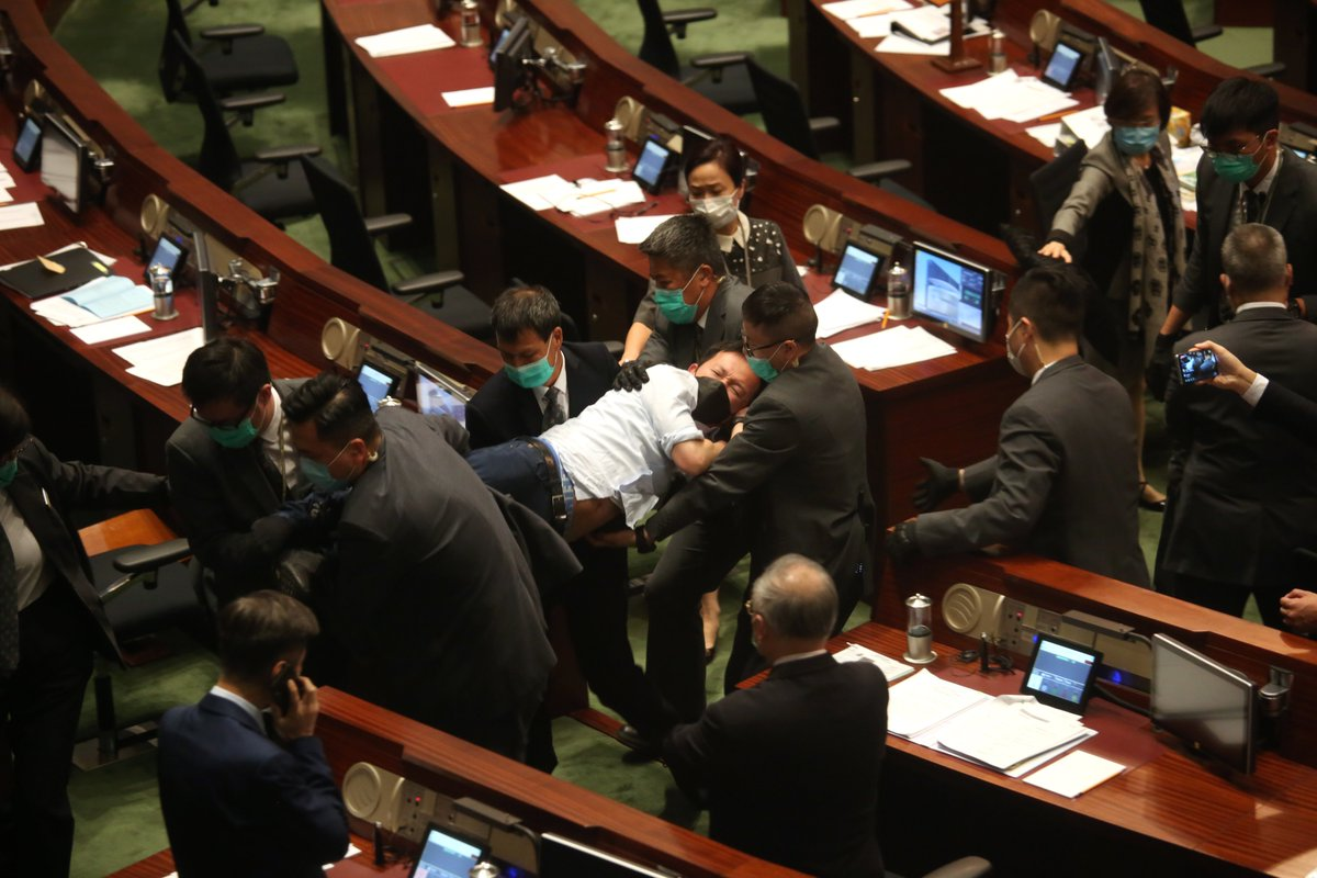 Opposition lawmakers' disorderly behaviors forced #HongKong's legislature to suspend vetting of the National Anthem Bill Thursday.  Ted Hui hurled a pungent and choking substance at president's seat, throwing #LegCo into disarray, leading to hospitalization of a lawmaker. https://t.co/GP3PZH3bDo