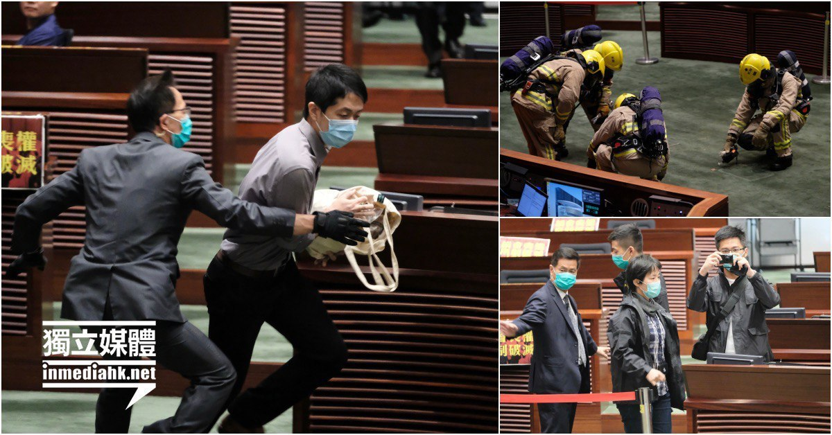 Democratic Party lawmaker Hui Chi-Fung tried to go to the chairman's seat w/ a rotten plant symbolized the death of #1Country2Systems but was stopped by security guards. The plant fell and released a pungent smell.  #Legco #StandWithHongKong #StandwithHK Source: Inmedia https://t.co/LN55HyHVhY