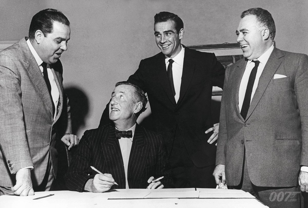Former naval intelligence officer, and daddy of Bond, Ian Fleming was born on this day in 1908. The first James Bond book he wrote was Casino Royale which was published in 1953. Pictured here with Fleming are Bond producers Harry Saltzman, Cubby Broccoli and Sean Connery.