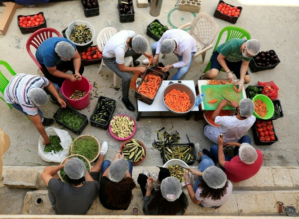 Photo of the Day: Volunteers prepare food for distribution to people in need, amid the spread of the coronavirus, in the port city of Sidon, southern Lebanon, May 27, 2020. (📸: Reuters/Ali Hashisho) . . . #photooftheday #potd #sidon #lebanon #coronav… https://t.co/n5PV5tbTJi https://t.co/xthCdiBtsu