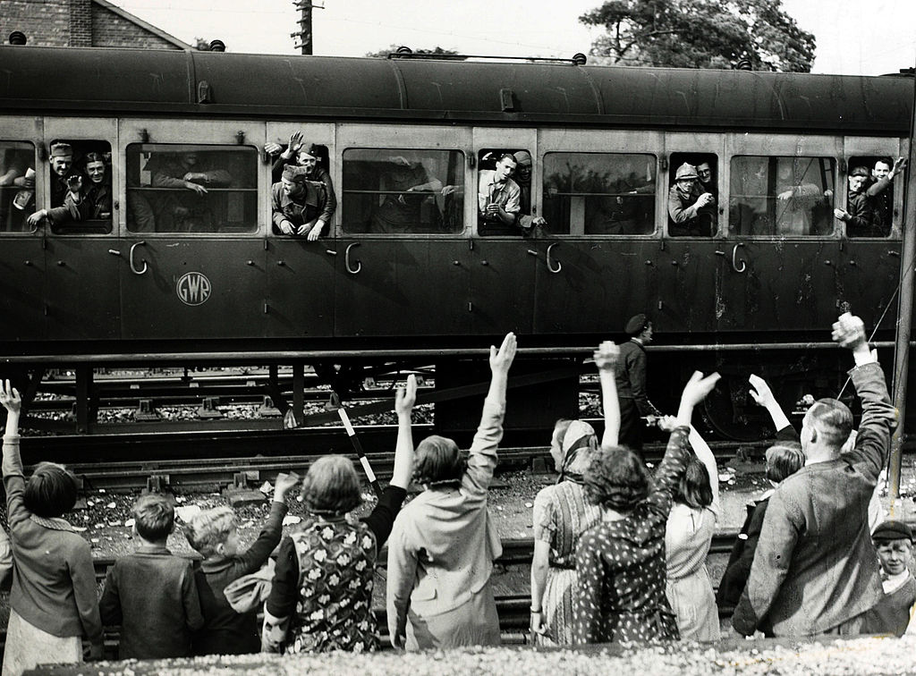 Men of the French Army greeted by villagers at a Kent railway station after their evacuation from Dunkirk, 1940. #History #WWII