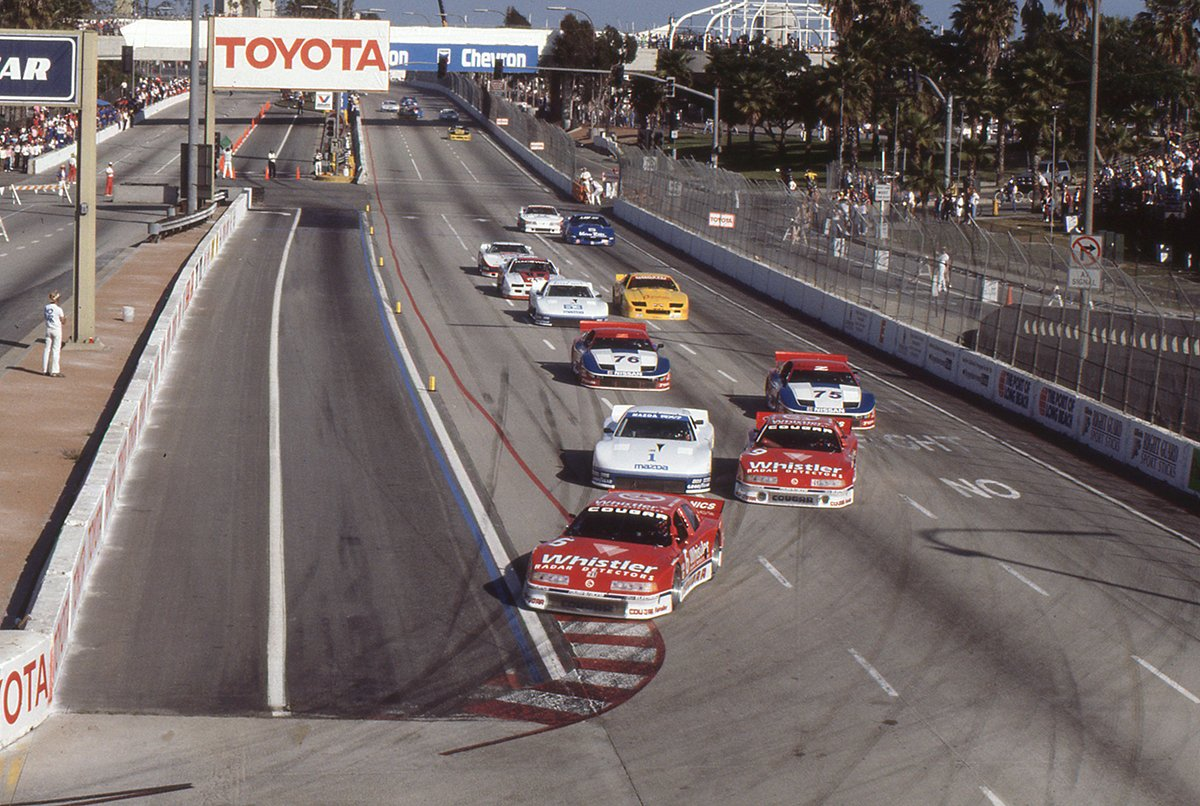 #ThrowbackThursday to the 1990 @IMSA GTO Race at Long Beach: Dorsey Schroeder, the eventual race winner, leads the field into Turn 1 with Pete Halsmer (#1) and @RobbyGordon (#9) in pursuit. Halsmer would finish second and Jeremy Dale (#76) third. Watch: youtube.com/watch?v=_J8PvC…