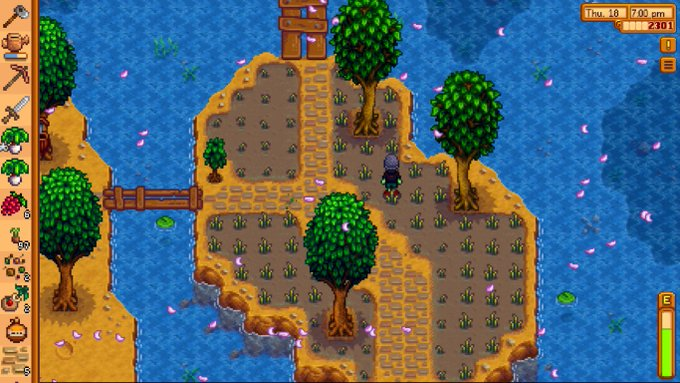 Screepcapture of the videogame Stardew Valley showing an island with rice fields and trees and a small character planting rice.