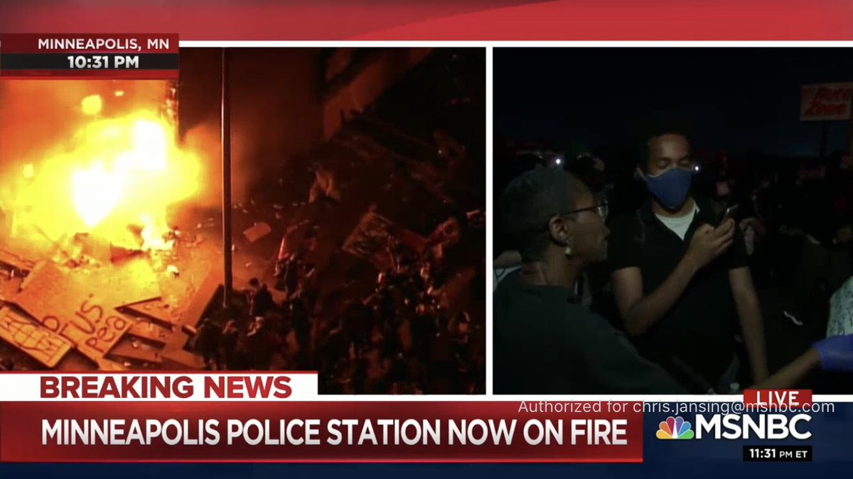 """The Minneapolis 3rd precinct police station is now ablaze as protesters chant """"What's his name? George Floyd!"""""""