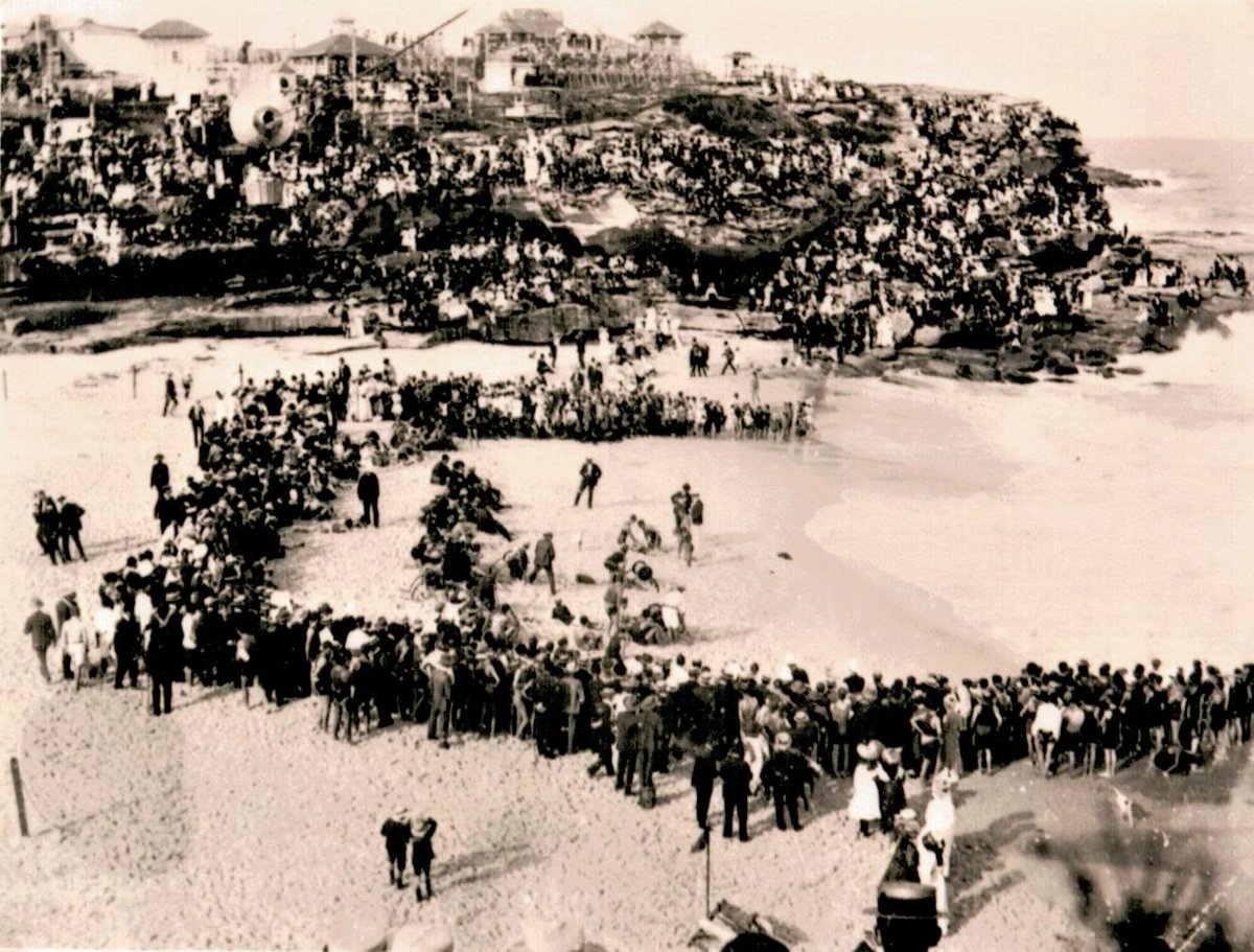 #FlashBackFriday Belt & Reel Competition Circa 1910 Belt and reels were a rescue device used since 1907. The picture is a surf carnival at Tamarama beach capturing a belt and reel race when Wonderland was still in operation. Belt & reels were only phased out in the '90's. pic.twitter.com/liDSejAKLV