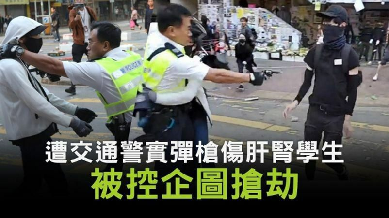 """Chow, the student who was shot by #HKPolice w/live rounds in #SaiWanHo last Nov. Chow & Wu, the young man in white hoodie, were now charged w/ """"deliberately obstruct #Police in the execution of their lawful duties"""" & """"attempting to snatch a police officer's gun"""".  #Court #May28 https://t.co/BV9oTScjjR https://t.co/AdMxYFZ4SF"""