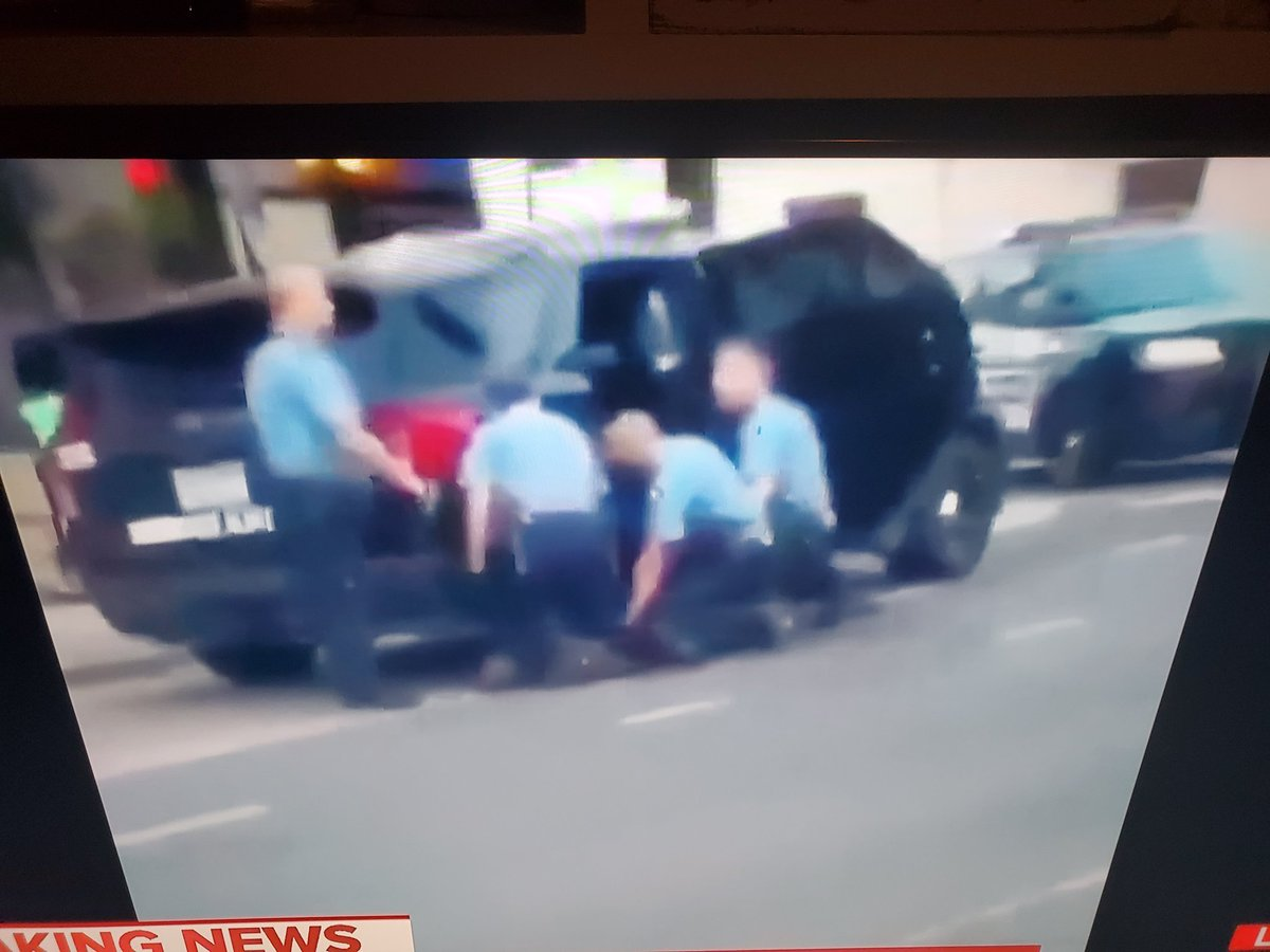 This is the view from the other side 3 officers with their knees buried in his back. This is murder. <br>http://pic.twitter.com/fzwa7ijHGW