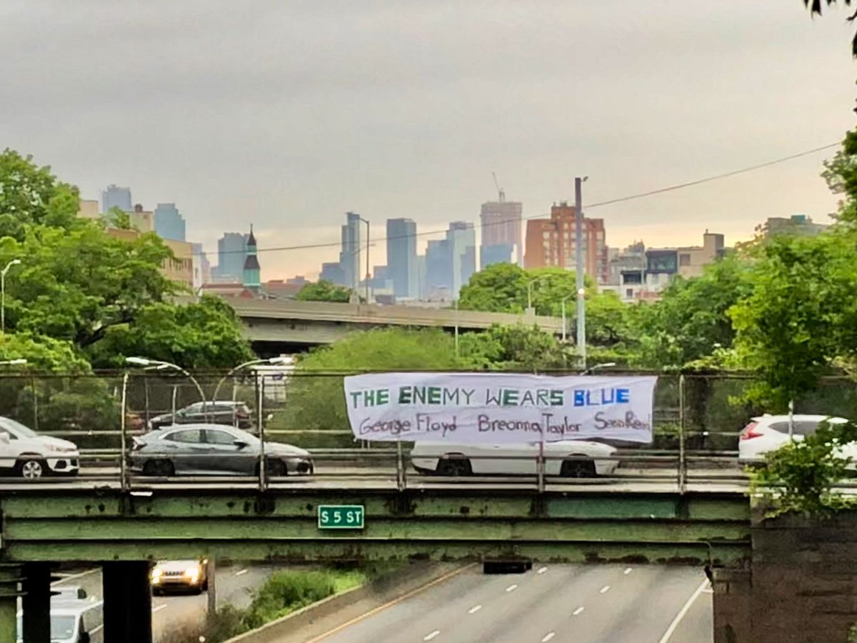 THE ENEMY WEARS BLUE.  Justice for George Floyd. Justice for Breonna Taylor. Justice for Sean Reed. Justice for Regis Korchinski-Paquet.  banner put up over the BQE this morning.  #ACAB<br>http://pic.twitter.com/o1PBz465Y9