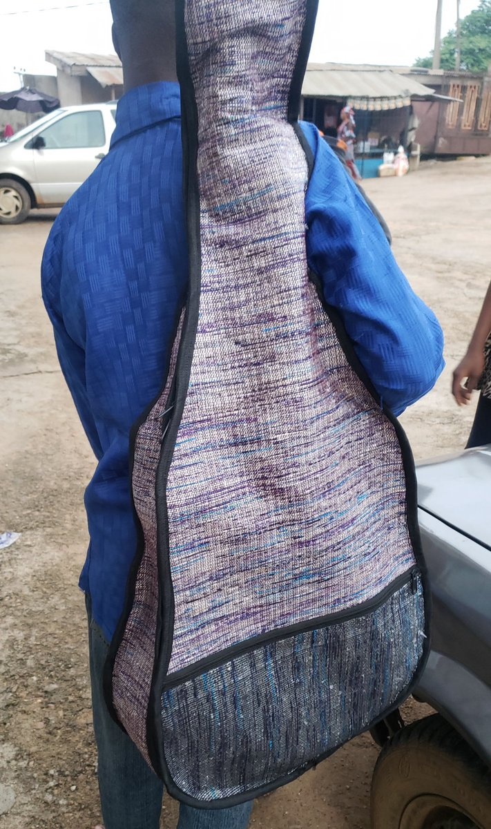 This guitar bag stops atleast 120 pure #water sachets #waste from going into landfill.   Handwoven and designed by #planet3r 90% wastes 10% cotton  Beautiful isn't it????  Kindly RT  #ClimateAction  #reducereuserecycle #music #MadeInNigeria #upcycledpic.twitter.com/3aW08MV45q