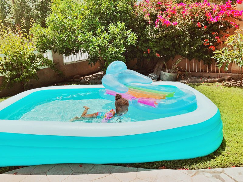 """This pool is EVERYTHING! We played Barbie's I did my ab workout (stationary leg kicks.. hurt sooo good) Christ BEGGED for a nap told me """"go play with daddy""""  I'm about to hit shuffle, blaze it and pretend I'm in Dubai.. I deserve alone time #momlife pic.twitter.com/01aOhuaSVW"""