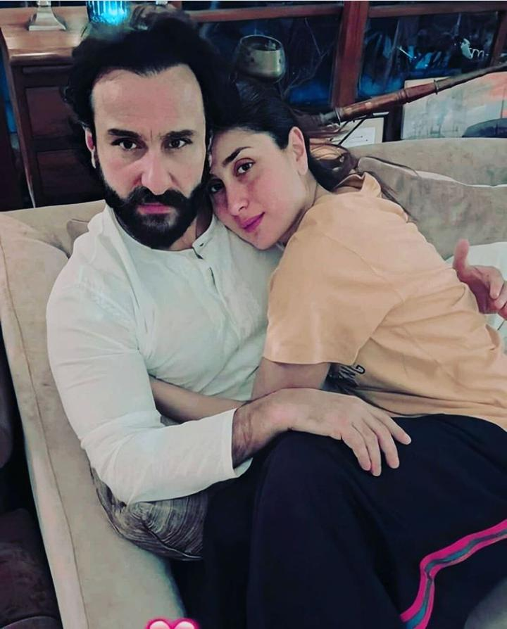 #KareenaKapoorKhan and #SaifAliKhan are all cuddled up in this picture.