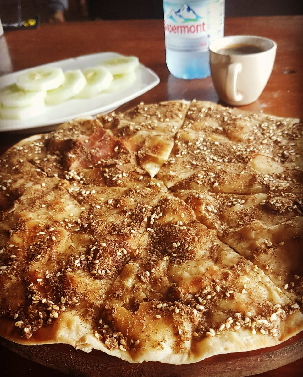 Saturday breakfast be like 😍 Pizza Zaa'tar (Thyme +olive oil) #goodday #fruits #love #fff  #l4l #lfl #breakfast #like4like #f4f #follow4follow #table #likeforlike #bread #instafood #instalike  #sandwich #instadaily #followforfollow #morningtime #instagood #morning