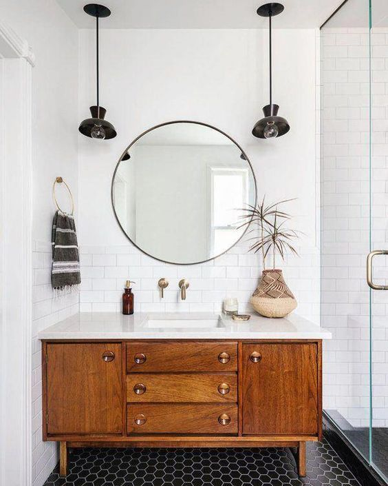 One factor in Mid-century Modern design is very minimalistic embellishments. This bathroom is the perfect example of that. I love the round mirror! . . . #midcenturymodern #interiordesign #minimalisticpic.twitter.com/49ksPGHARo