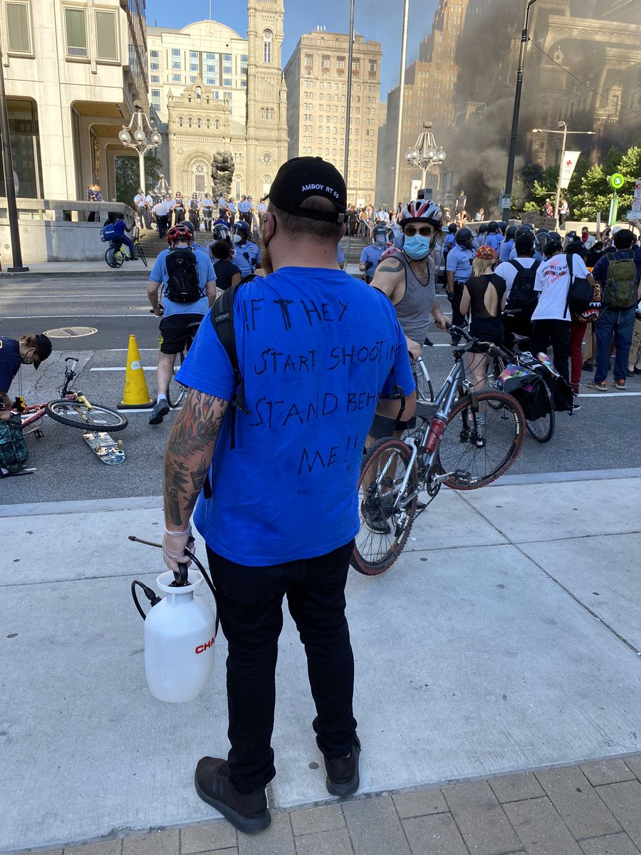 This man and is beautiful shirt are going around offering to sanitize people's hands and giving away gloves for free. #PhillyProtest https://t.co/FJ90OMstle