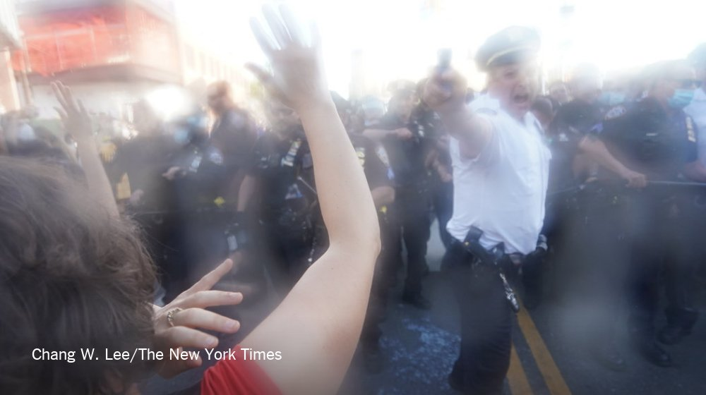 A police officer pepper spraying protesters in Brooklyn https://t.co/thOWq6p1JN https://t.co/HhrcxxvO9a