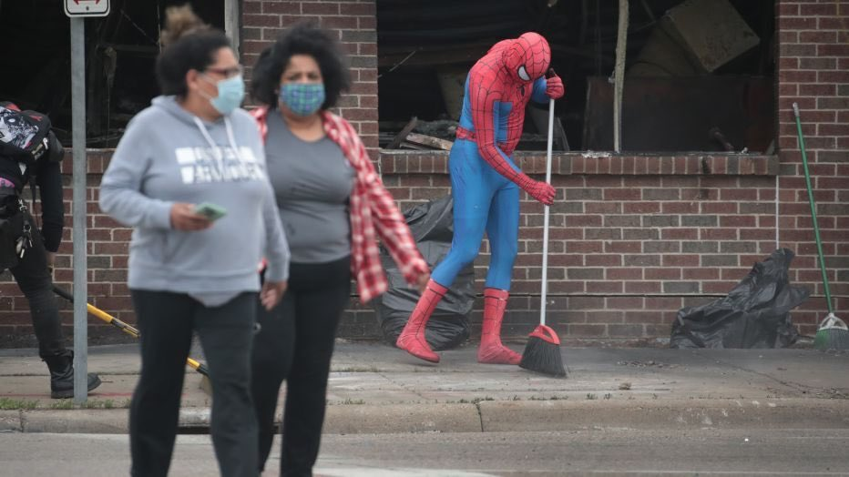 Friendly Neighborhood Spider-Man seen helping clean up trash, graffiti and debris following Twin Cities protests. (Photo by Scott Olson/Getty Images)