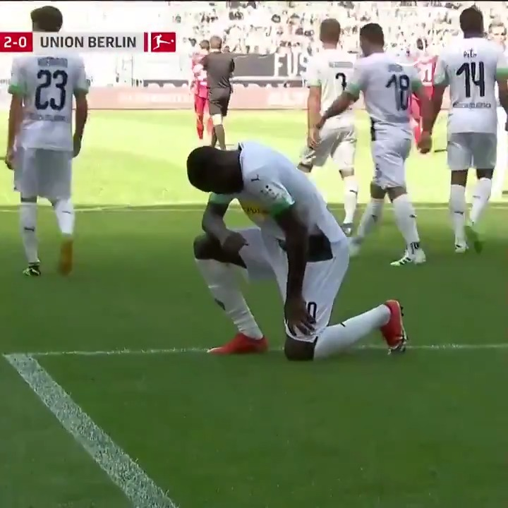 Marcus Thuram takes the knee after scoring for Gladbach.