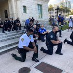 Image for the Tweet beginning: Police taking a knee in