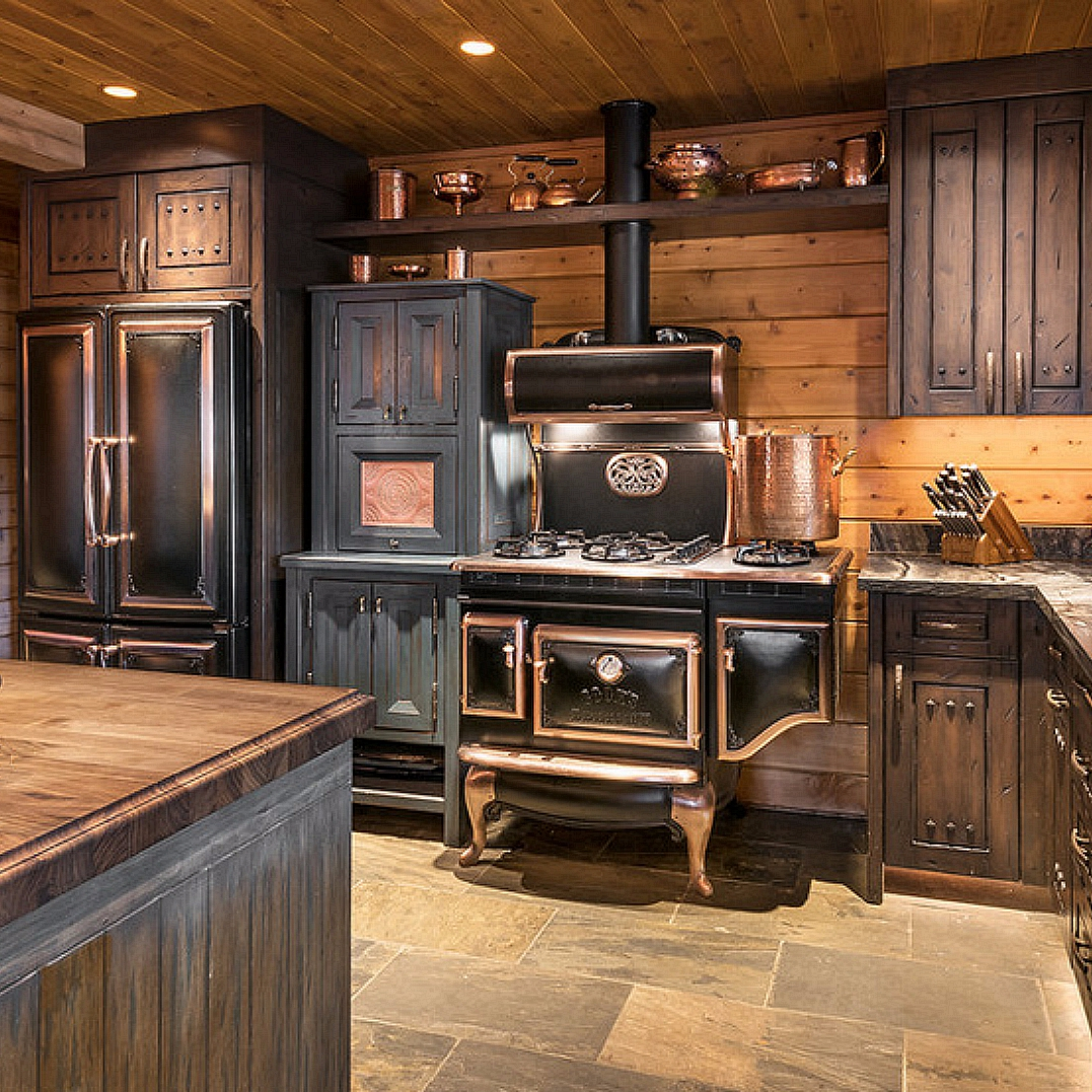 The statement-making range with copper accents perfectly complements the rustic look!  #kitchenlove #rustic #vintage #antiqueappliances #kitchenideas #kitchendecor #kitchenremodel #kitchen #farmhousekitchen #farmhousestyle
