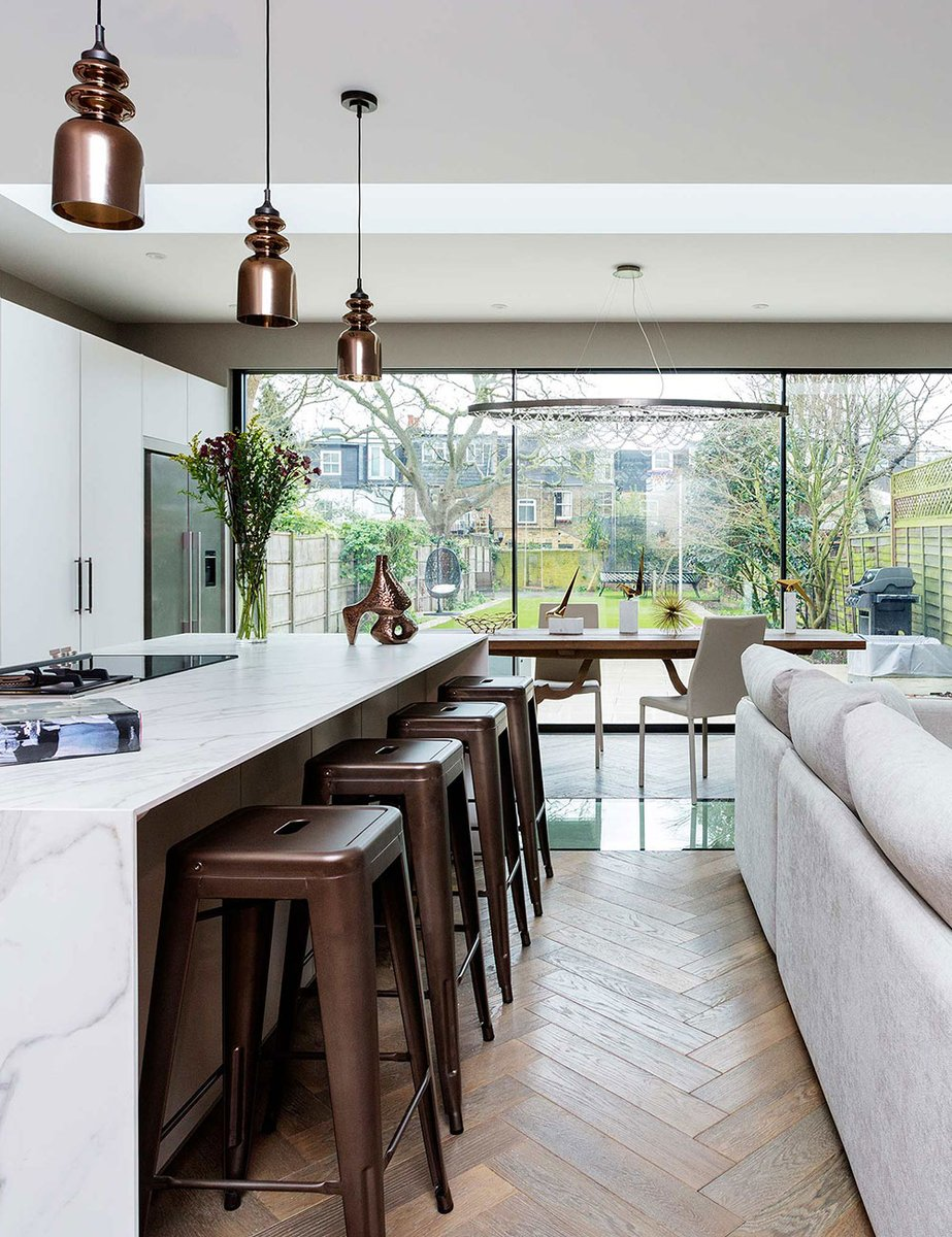 The full width family kitchen & snug is in pole position at back of the house. This huge space has a full width skylight over the extension, where shards of light now bathe the basement #bespokekitchens #luxuryhomes #joinery https://hux-london.co.uk/portfolio/view-by-project/ …pic.twitter.com/c063zePiAd