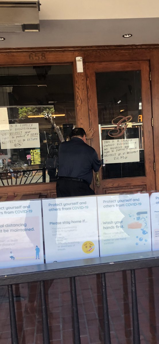 This is in downtown #SanDiego where business owners are closing up shop early and putting up signs/drilling plywood in an attempt to prevent potential looting pic.twitter.com/4rhgbPjFZ1