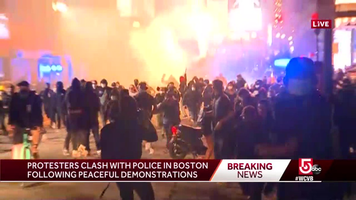 This screen capture near Emerson College and #BostonCommon show tear gas and fireworks being shot off to disperse crowds following #BostonProtests. on.wcvb.com/2MgAXHt