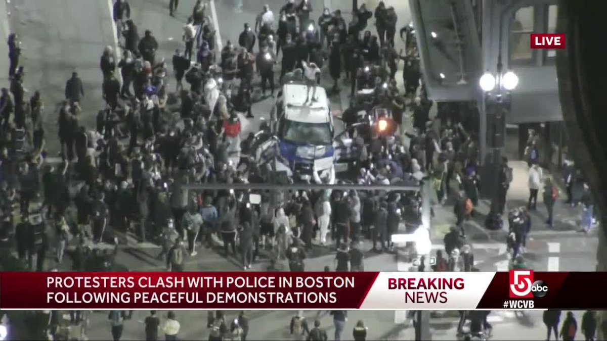 A photo shows a #BostonPolice SUV that was seriously damaged and vandalized with graffiti by crowds. Protesters jumped on top of it and repeatedly kicked it. #BostonProtests on.wcvb.com/2MgAXHt