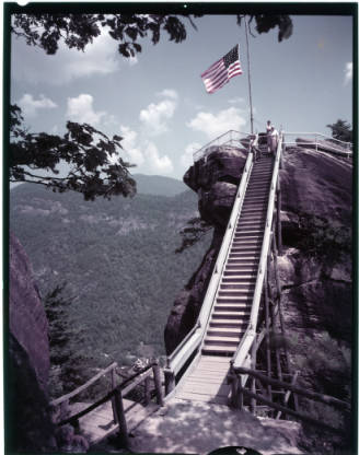 Chimney Rock's iconic 315-foot rocky spire provides panoramic views of Hickory Nut Gorge and Lake Lure. Chimney Rock became an official NC State Park in 2006 after being under the care of Dr. Lucius B. Morse of Missouri and his family since 1902. #VacationNC #chimneyrockNC https://t.co/ONpqeDPpnL