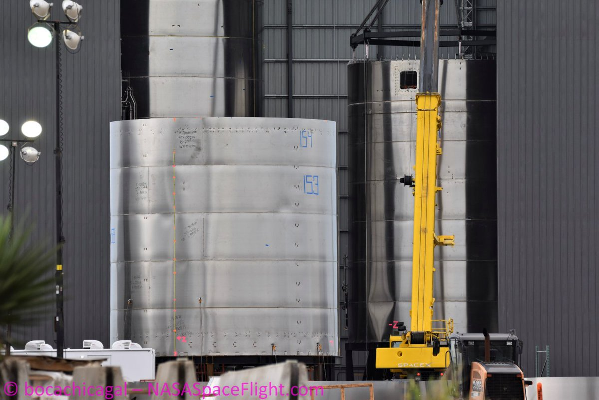 SN6 stacking going on beside the largely complete SN5. We'll be back at the launch site for more testing quicker than... a really quick thing. 😜  Full image by @BocaChicaGal / @NASASpaceflight at