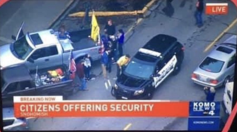 """Armed white supremacists deployed to Snohomish yesterday, flying confederate flags and carrying assault rifles. They were welcomed by police, and KOMO framed their actions as """"citizens offering security"""". https://t.co/zF2uL4K2Je"""