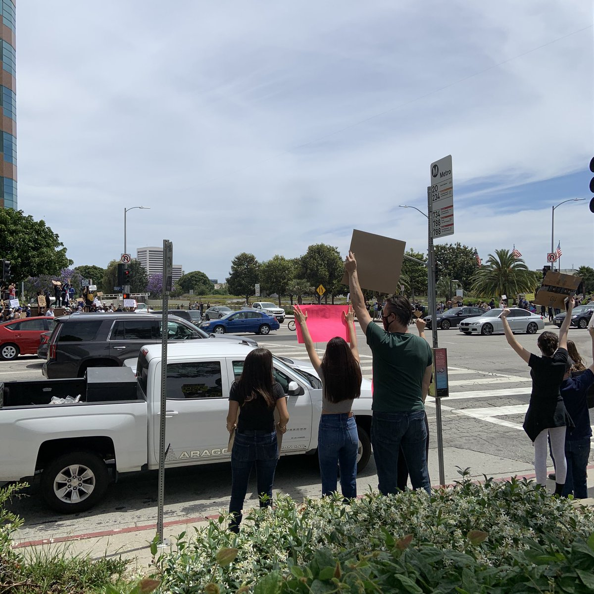 As peaceful protest has begun at the corner of Wilshire and Veteran in #LA the National Guard just rolled in.