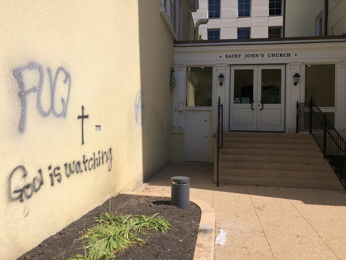"""God is watching,"" someone painted on the side of St. John's Episcopal over the weekend."