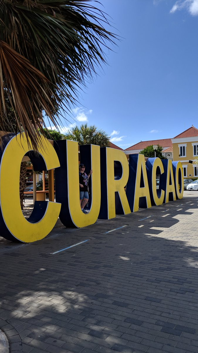 2019-01 Panama Canal cruise: Just in case we forgot where we were, there were these huge letters to remind us that we were in #Curaçao!  The 2nd photo has my new friends, @EdithMusch and Linda, having fun! Edith is #Dutch which came in handy with the signs here!pic.twitter.com/qkB4OMiIjO