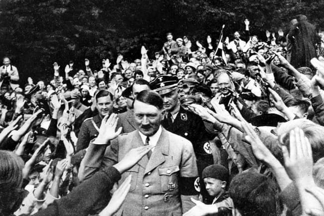 @mickiemhall Sorry this is a FAKE image of Hitler photoshopped with a bible. If you look closely - its the same small hands of Trump holding the bible.