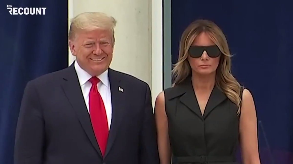 Trump asks Melania to smile during today's photo op.