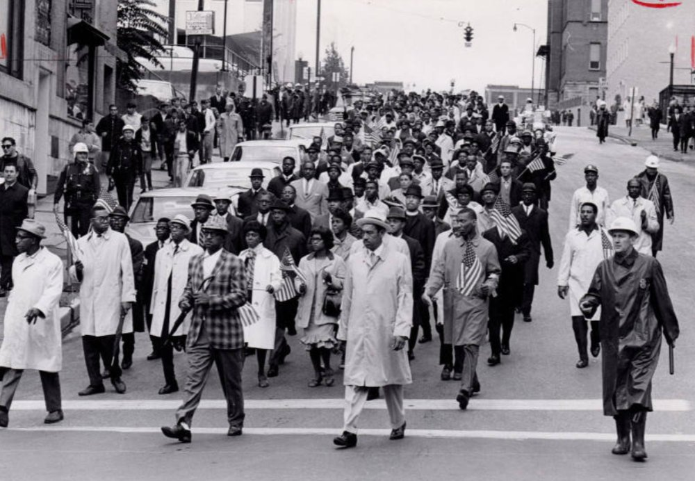 From our SummitMemory.org archive: Photograph of protest marchers on E. Center Street in Akron, 1966. The march was organized by Edwin Parms, local NAACP president, to protest police brutality.