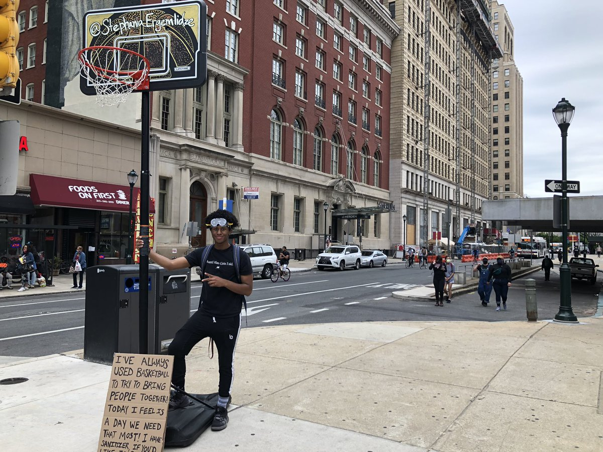 Khalil Gardner is a part of a group dragging a basketball hoop around center city trying to get people to play to break the tension.
