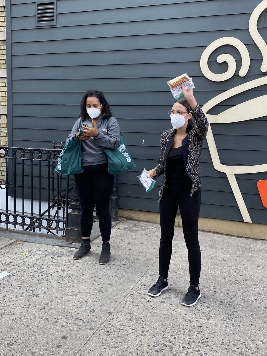 ".⁦@AOC⁩ handing out masks in Queens protest. ""Wear your masks! Let's go!"""