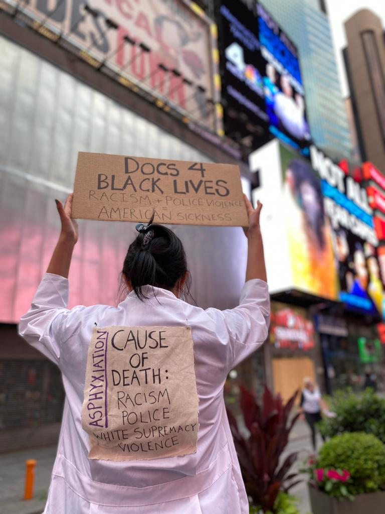 Hundreds of healthcare workers in Times Square tonight in solidarity with #BLM. Racism and police terror are public health EMERGENCIES. We must #DefundNYPD now -- time to invest in social services, communities, and healing. #frontlinesforfrontlines #whitecoats4blacklives