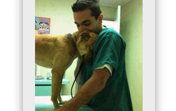 Dog says thank you to his veterinarian