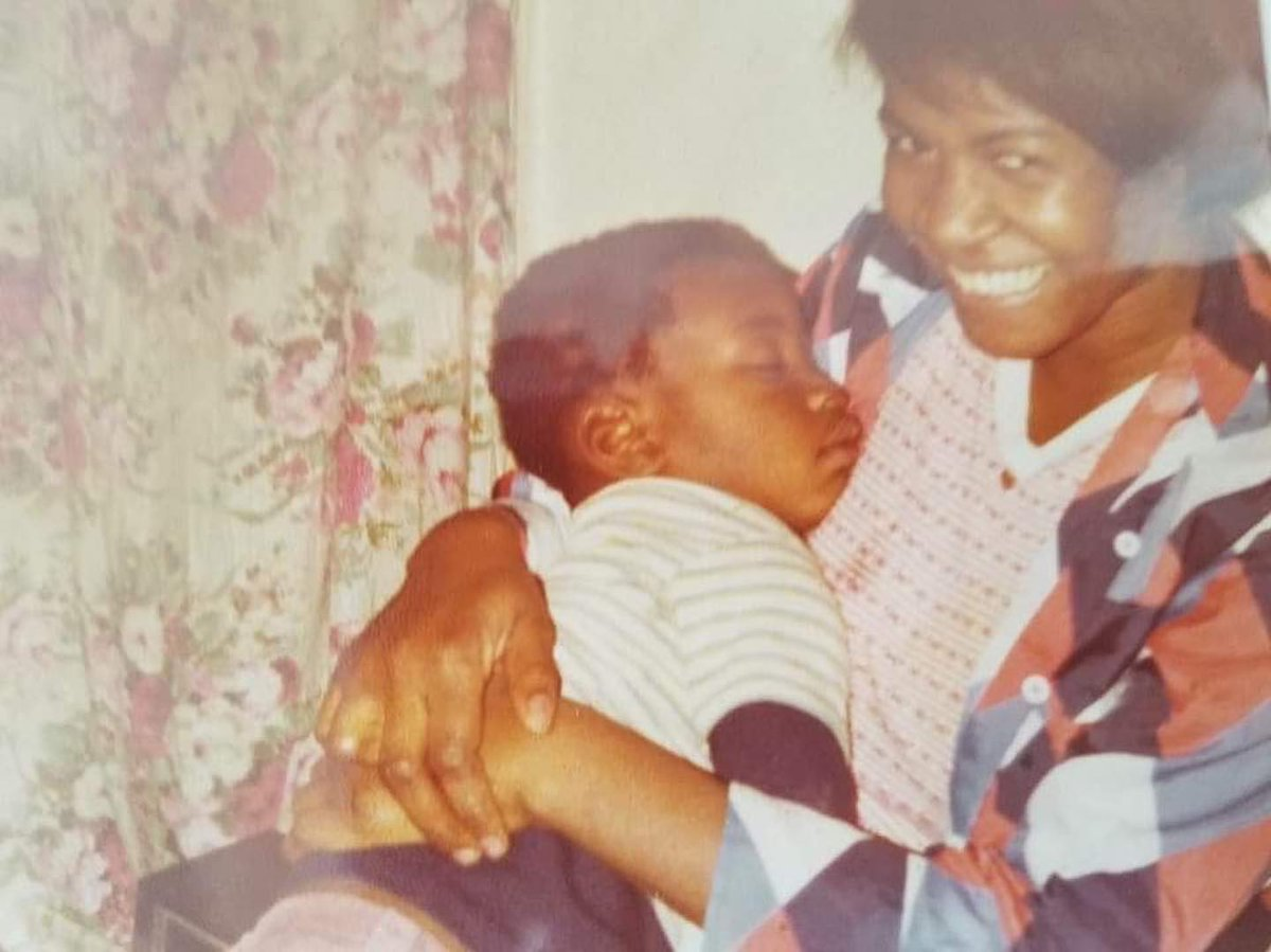 Young George Floyd in his mother's arms.