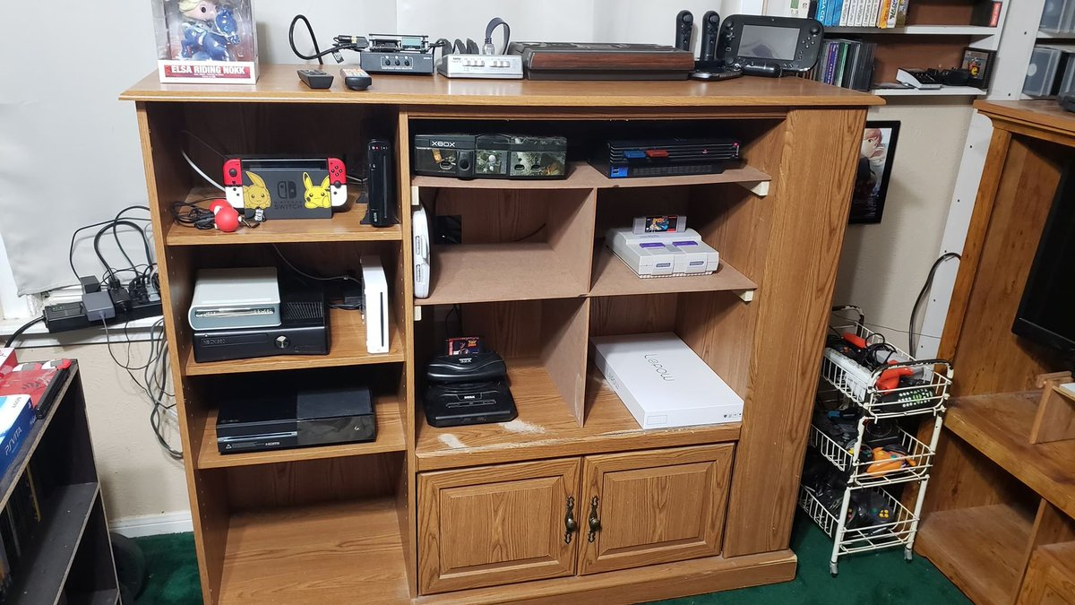 Two days, a 12-plug surge protector, a lot of sweat and some woodworking later, my new setup is complete!   And the best part? Everything still works! That my favorite part.   Now I have a LOT of space to continue expanding whenever I get new consoles!