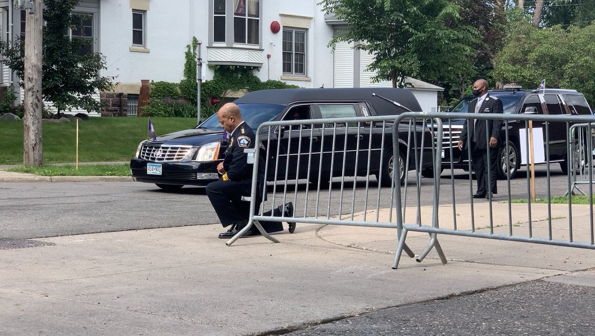 Police officers took a knee as the hearse carrying George Floyd arrived at his memorial service.
