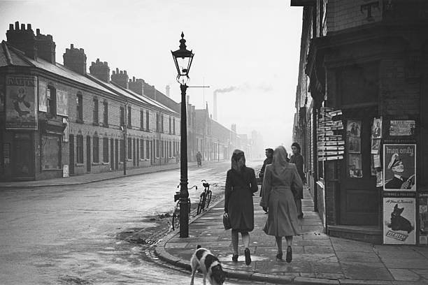 #Leicester 1945  Lot going on in this photo  Note the large Ovaltine Poster and smoking chimneys  Busy dog and note the Men Only Magazine advert  Men only was not as we know it today but still fairly risque in 1945  A man on his bike and ladies in headscarves   Great photo https://t.co/AZGv1sZbEq