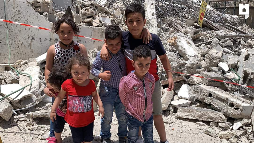 The children of Abu Dhiab family stand on the rubble of their house, which was demolished by the occupation this morning in Silwan.  #IsraeliCrimes #Act4Palestine<br>http://pic.twitter.com/DeTgQgQVay