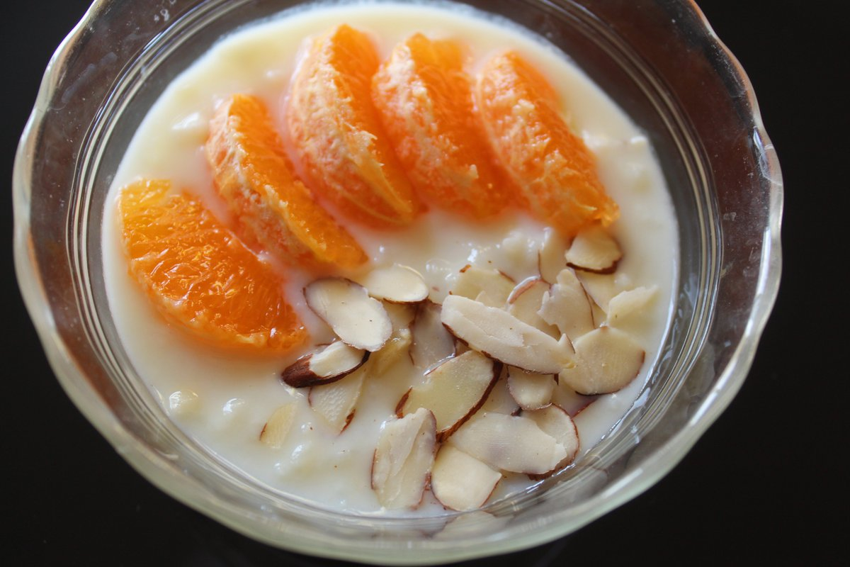 Infusing tangerine peel in my rice pudding gave the dessert such a lovely flavor! I garnished it with segments of sweet, juicy Ojai Pixie Tangerines and sliced almonds. @MelissasProduce #rice #pudding #dessert #tangerines #ricepudding