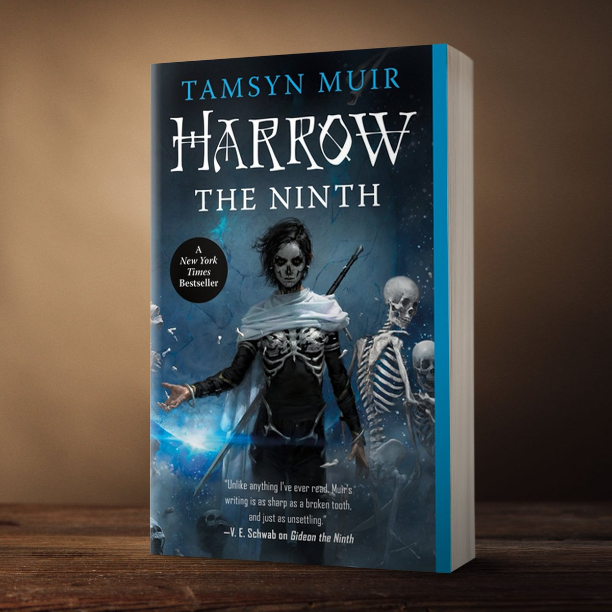 """""""Unexpectedly, this did not kill her; and what did not kill her made her curious.""""  Happy #bookbirthday to the paperback edition of HARROW THE NINTH by @tazmuir! 💀💙 publishing.tor.com/harrowtheninth…"""