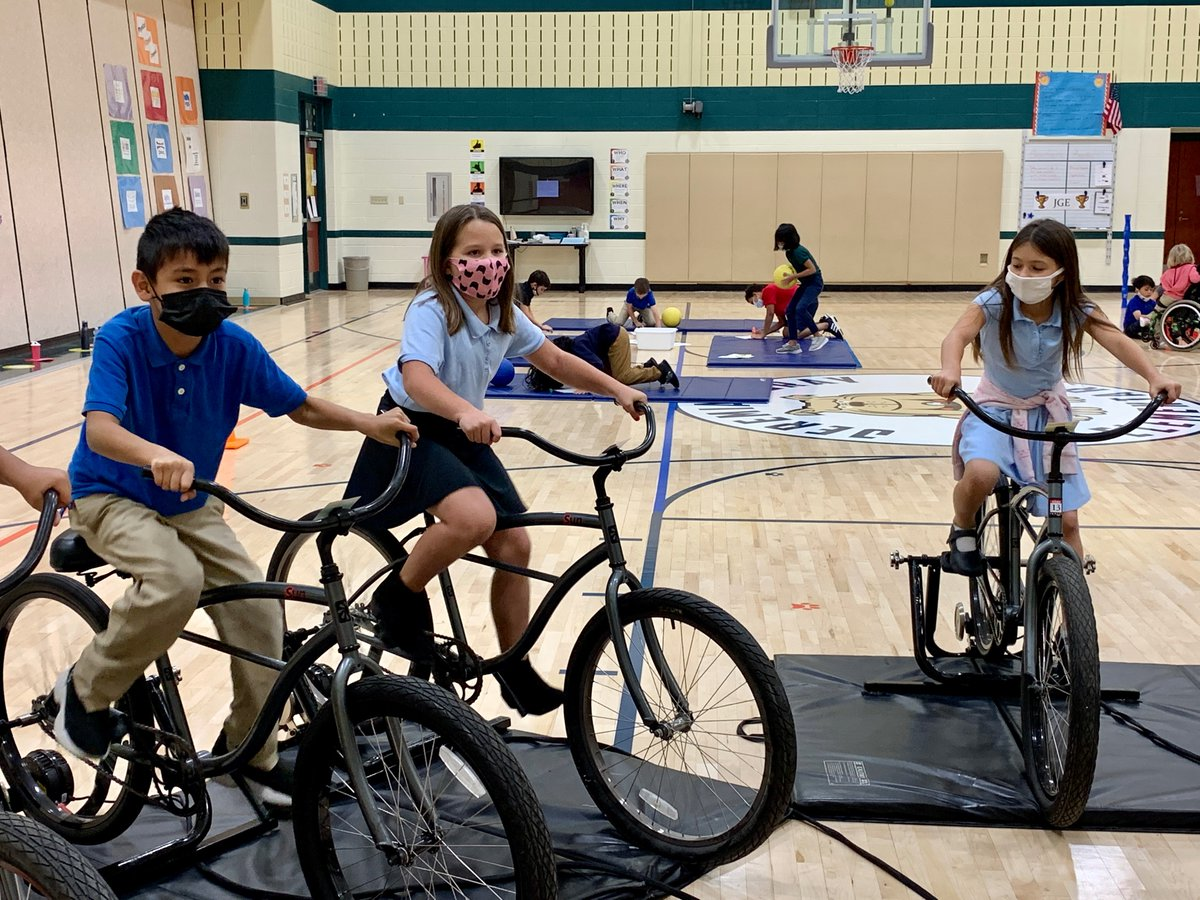Students at @JGElementary are getting strong & healthy this week in Ms. Young's PE class with bicycles & technology! Students pedal multiple courses of varying length & difficulty, then track their speed, power output & distance. Thank you, @Nine13sports  this opportunity!