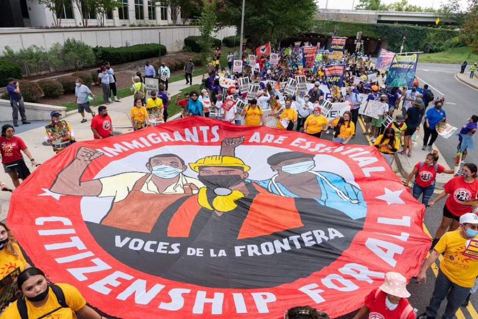 Wisconsin immigrant essential workers carry an #ImmigrantsAreEssential parachute through D.C. during a massive march. We demand Democrats deliver #CitizenshipForAll in the #BuildBackBetter Reconciliation Bill. #WelcomeBackCongress #WeAreHome Photo credit @JosephBrusky