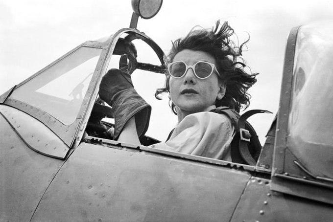 A UK female spitfire pilot, 1944, known as a ferry pilot, delivering newly manufactured aircraft from the factory to military airfields #WomensArt
